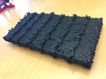 Photo - A 3-D-printed model of a peptoid nanosheet, showing patterned rows of sugars. (Credit: Berkeley Lab)