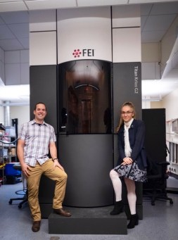 First author Basil Greber (left) and study leader Eva Nogales (right) stand in front of their Titan Krios G2 cryo-electron microscope, one of the most powerful cryo-EM instruments currently available, at the Bay Area Cryo-EM (BACEM) facility in Berkeley, California.