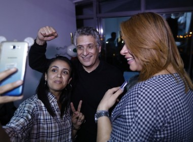 Tunisian presidential candidate and media magnate Nabil Karoui (C) poses for a selfie with supporters at his campaign headquarters, after he was released from Mornaguia prison