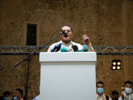 Libyans Protest as PM Cheers Crowd at Mass Wedding (News Central TV)