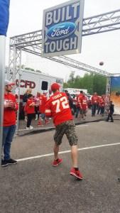 cardinals_draft_party_football_toss_3