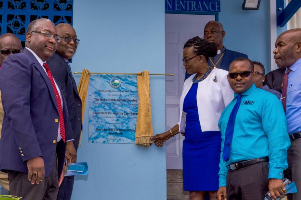 PROUD MOMENT: Unveiling the commemorative stone at the commissioning of the Blue Room on Tuesday are (from left) TRHA CEO Sheldon Cyrus, Chief Secretary Kelvin Charles, Health and Wellness Secretary Dr Agatha Carrington and founder of BMEN Organisation Michael Stewart on Tuesday in Scarborough.  - DAVID REID