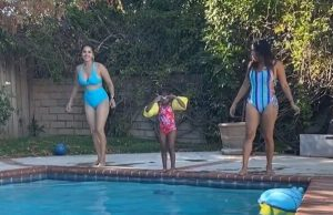 sunny-leone-enjoys-in-pool-with-daughter-nisha-kaur