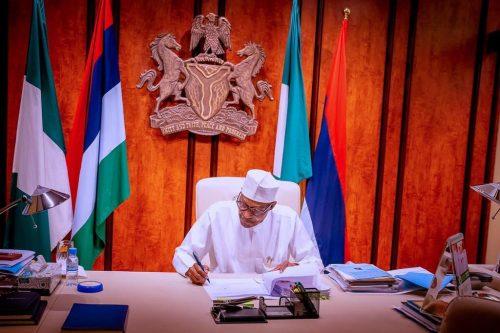 Buhari signing PIB into law