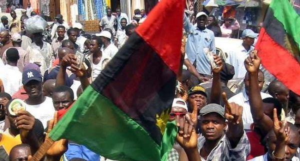 •Pro-Biafra agitators during a procession.