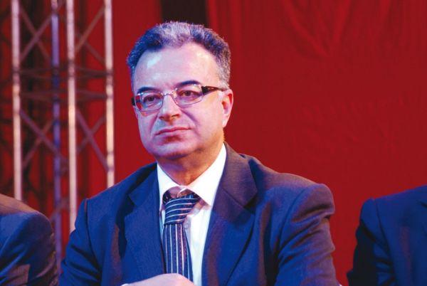 •Late Tunisia's health minister Slim Chaker