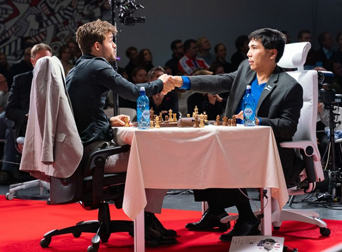 So and Carlsen shakes their hands with each other
