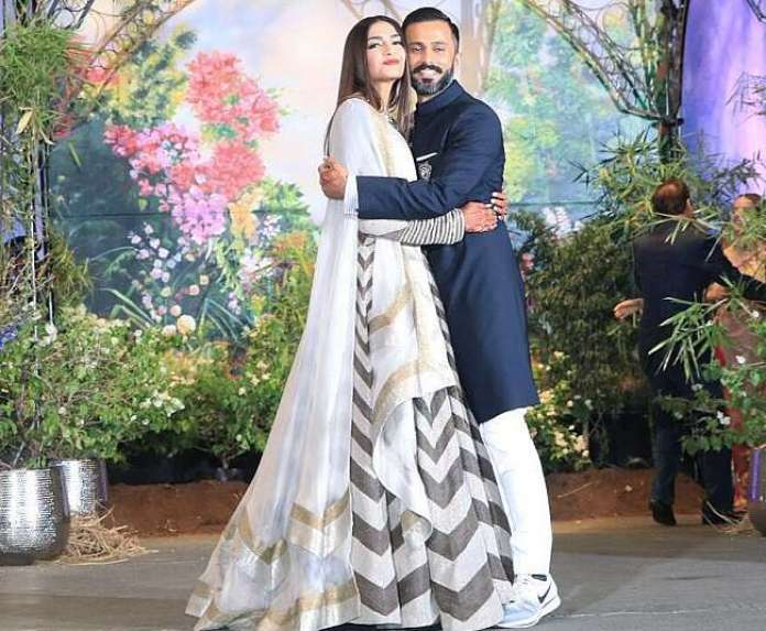 watch the latest photos of sonam kapoor and anand ahuja wedding reception