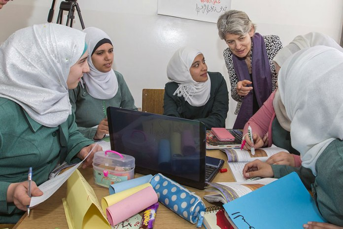 Director-General Irina Bokova (standing), visiting UNESCO education and communication projects supporting Syrian refugees in Jordan. Photo: UNESCO/Abed Arslan
