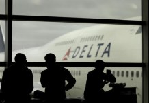 Delta Air Lines passengers wait for flights in Detroit. ?