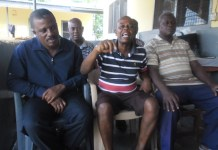 The NDC?s Constituency Chairman for the area, Francis Addo-Quaye (middle), with other executives