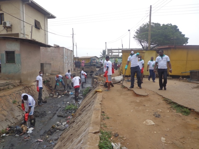 Pictures show the people busily undertaking the clean-up exercise at La