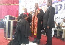 Rt Rev. Dr Edem Tettey lay hands on one of the pastors