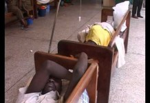 Some cholera patients receiving treatment on benches