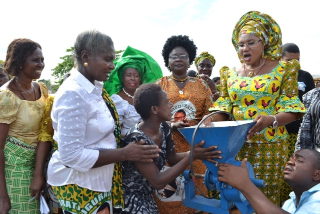 (L-R) First Lady of Anambra State, Chief (Mrs) Ebelchukwu Obiano handing over a grinding machine, on her right is the Commissioner for Women Affairs Dr. Mrs Victoria Chikwelu during handover of empowerment items donated to indigent widows in Anambra State