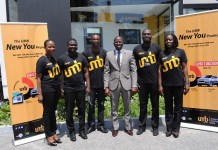 UMB Marketing and Communication staff in a pose with Ekow Incoom(m), a representative of National Lottery Authority.