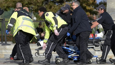 Emergency staff tended to the injured at the memorial