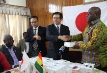 Japan Ambassador Kaoru Yosghimura presenting the items to the Deputy Minister, Dr Victor Asare Bampoe.