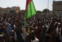 Pro-democracy protesters chant slogans against military rule at Place de la Nation in Ouagadougou, capital of Burkina Faso, November 2, 2014