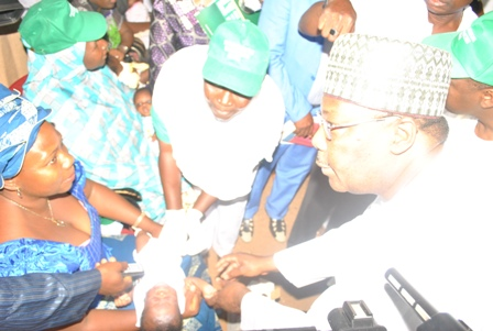The Executive Deputy Governor of Kogi State, Architect Yomi Awoniyi administering the newly launched Pneumonia Vaccine in Nigeria while other health workers assisting him at the National Launch for Pneumonia Vaccine introduction in Nigeria by the National Primary Health Care Development Agency held in Lokoja Kogi State today.