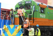 Port workers inspect one of the three locomotives as they were being off-loaded from the BBC Oder at the Port of Mombasa. The locomotives are expected to help Rift Valley Railways boost efficiency. Photo: Gideon Maundu/Standard