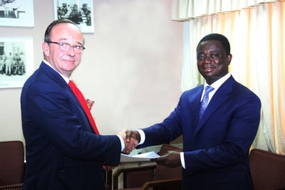 Mr Patrick de Boussac, Chief Executive of CTPC (left) exchanging copies of the signed agreement with Dr. Stephen Kwabena Opuni, Chief Executive of COCOBOD