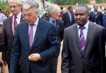 Reynders (L) and Bugesera mayor Louis Rwagaju walk into the offices of Nemba one-stop border post yesterday. The Belgian minister said his country has not suspended aid. (Timothy Kisambira)