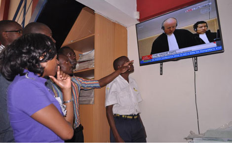 Kisumu residents following proceedings at the International Criminal Court on television