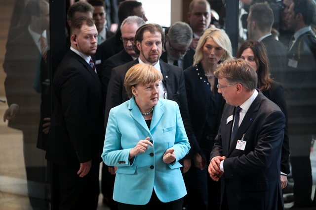 German Chancellor Angela Merkel(L, front) arrives for the opening ceremony of CeBIT 2015 in Hanover, Germany, on March 15, 2015. Top IT business fair CeBIT 2015, which features a strong Chinese presence, kicked off on Sunday in Germany. (Xinhua/Zhang Fan)