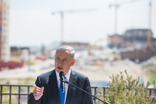 Israeli Prime Minister Benjamin Netanyahu addresses a campaign trail in the east Jerusalem Jewish settlement of Har Homa, on March 16, 2015. Israeli Prime Minister Benjamin Netanyahu told an Israeli news website Monday that if he is elected in Tuesday's national elections,