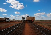 A truck passes a segment of old railway at a construction site on section two of Kenya's Standard Gauge Railway project, near Voi, Kenya, on March 19, 2015. The project, expected to cost 3.8 billion U.S. dollars, involves the construction of about 480 kilometer railway line from the port city Mombasa to the capital city Nairobi. China Roads and Bridges Corporation (CRBC) is undertaking the project. (Xinhua/Pan Siwei)