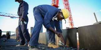 Workers work on a construction site on section six of Kenya's Standard Gauge Railway project, near Makueni, Kenya, on March 16, 2015. The project, expected to cost 3.8 billion U.S. dollars, involves the construction of about 480 kilometer railway line from the port city Mombasa to the capital city Nairobi. China Roads and Bridges Corporation (CRBC) is undertaking the project. (Xinhua/Pan Siwei)