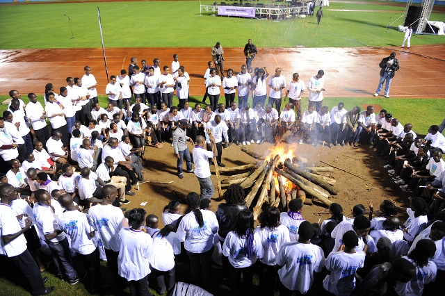 Youth surround a bonfire during the ?Night Vigil? as part of events to mark the 18th Genocide Commemoration in Kigali, capital of Rwanda, April 7, 2012. Youth use the ?Night Vigil? to remember innocent Tutsis killed in the 1994 genocide. The theme of this year?s anniversary is: