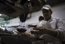 A worker makes chocolate Easter eggs preparing for Holy Week at the company of Chocolate Arrufat in Buenos Aires, capital of Argentina, on Apr. 1, 2015. Arrufat is one of the 150 recovered factories that are led by their employees, currently has 28 employees and plan production for easter of about seven thousand kilograms of chocolate. (Xinhua/Martin Zabala)