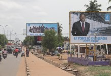 Photo taken on April 13, 2015 shows election campaign billboards for Faure Gnassingbe, Togolese President in Lome, capital of Togo. Togo?s Presidential elections will be held on 25 April 2015. (Xinhua/Zhang Gaiping)