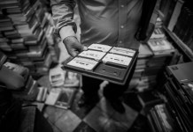 A man holds an audiobook at a bookstore in Mexico City, capital of Mexico, April 20, 2015. (Xinhua/Pedro Mera)
