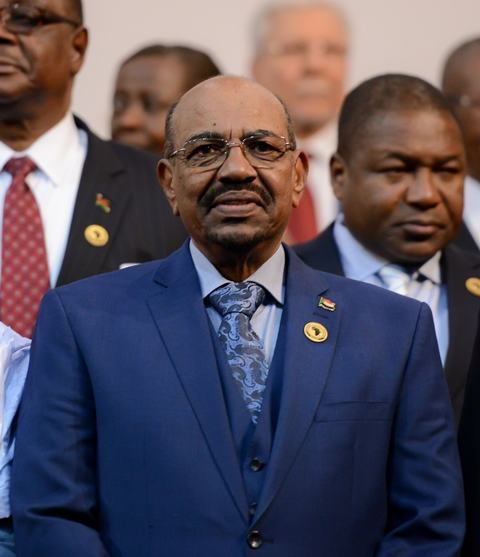 Sudanese President Omar al-Bashir gestures during the photocall before the opening of the 25th African Union (AU) Summit at Sandton Convention Center in Johannesburg, South Africa, on June 14, 2015. Sudanese President Omar al-Bashir attends the 25th AU Summit here despite International Criminal Court's arrest warrants. (Xinhua/Zhai Jianlan) (lrz)