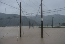 Photo taken on July 11, 2015 shows farmlands submerged by flood water in Qiantan Village, Sanmen County of east China's Zhejiang Province. The approaching Typhoon Chan-Hom has brought gales and rainstorms to Zhejiang Province, east China, forcing hundreds of flights to be canceled and highways to be closed, local authorities said Saturday. (Xinhua/Xu Yu) (zwx)