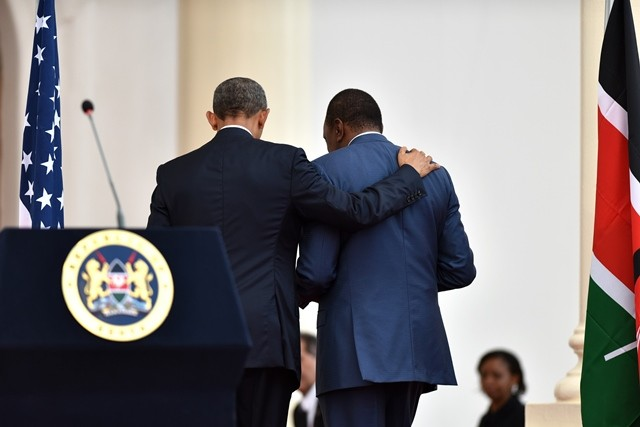 U.S. President Barack Obama (L) and his Kenyan counterpart Uhuru Kenyatta leave after their joint press conference in Nairobi, Kenya, July 25, 2015. Kenya and the U.S. on Saturday reaffirmed their commitment on security cooperation and in the war against terrorism to help prevent future terror attacks in the East African nation. (Xinhua/Sun Ruibo)