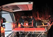 An injured passenger is loaded into an ambulance at the Booysens train station near Johannesburg Friday July 17, 2015. More than 200 people were injured in a train collision in Johannesburg on Friday night, authorities said, with more injuries expected as more passengers are known to still be trapped inside the wrechage. No fatalities have been reported. (AP Photo)