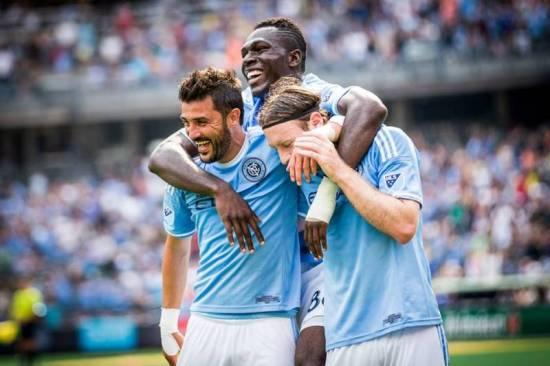 Kwadwo Poku celebrates City goal with David Villa