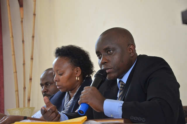 Umar Kiyimba the Electoral Commission officer in charge Elgon responds to questions during the meeting at Wash and Wills Hotel while Peninah Sekabembe, the EC principal election officer looks on.