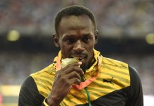"Gold medalist Jamaica's Usain Bolt poses during the awarding ceremony of the men's 100m event at the 2015 IAAF Wolrd Championships at ""Bird Nest"" National Stadium in Beijing, capital of China, Aug. 24, 2015. (Xinhua/Gong Lei)"