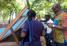 Mr Ebenezer Appah-Sampong (right), Deputy Executive Director, EPA inspecting a snail pen