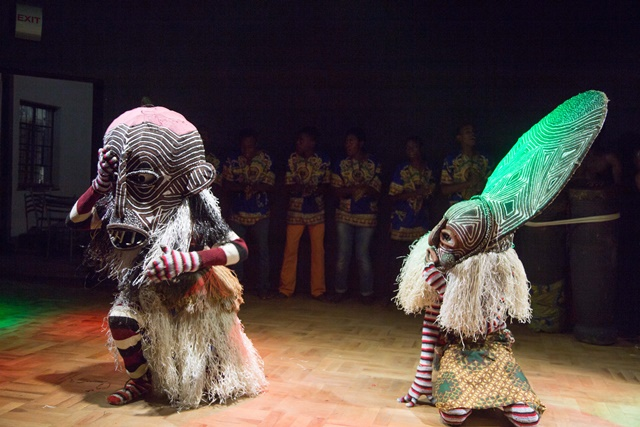 Zimbabwean dancers perform traditional Makishi dance at Old Mutual Theatre, Harare, Zimbabwe, on Oct. 9, 2015. Makishi dance, originally performed at the end of an annual initiation ritual for boys between the ages of eight and twelve in rural Zimbabwe and Zambia, is particularly known for involving beautifully painted masks that represent different spiritual characters. Today, there is an increasing demand for makishi dancers at social gatherings and party rallies, as they are less performed for initiation rituals. The dance was recognized as a UNESCO oral and intangible cultural heritage in 2008. (Xinhua/Xu Lingui)