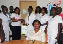Co coordinator of Pledge Pink at UT Bank, Mrs. Zara Neequaye presenting a souvenir to the Korle- Bu Hospital staff