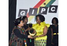 Ms. Esther Cobbah receiving award at the GC 100 award ceremony