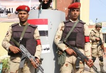 Egyptian soldiers stand guard outside a polling station in Cairo, Egypt, on Nov. 22, 2015. Egyptians began voting Sunday in the second phase of the country's first parliamentary election since Islamist President Mohamed Morsi was ousted in 2013. (Xinhua/Ahmed Gomaa)