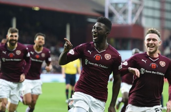 Midfielder Prince Buaben wheels away in celebration of his first goal in 14 games