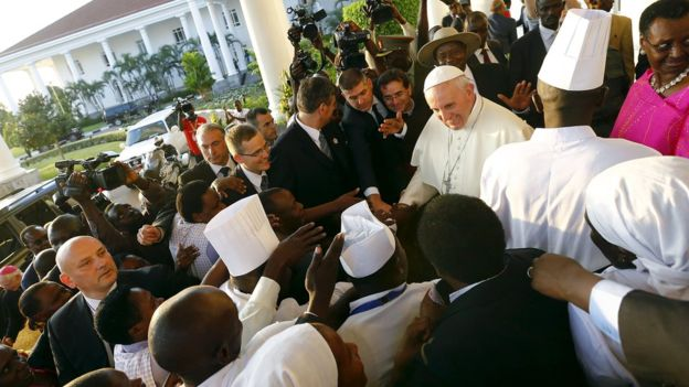 Pope Francis was greeted enthusiastically on Friday as he arrived to meet President Yoweri Museveni at the presidential palace in Kampala